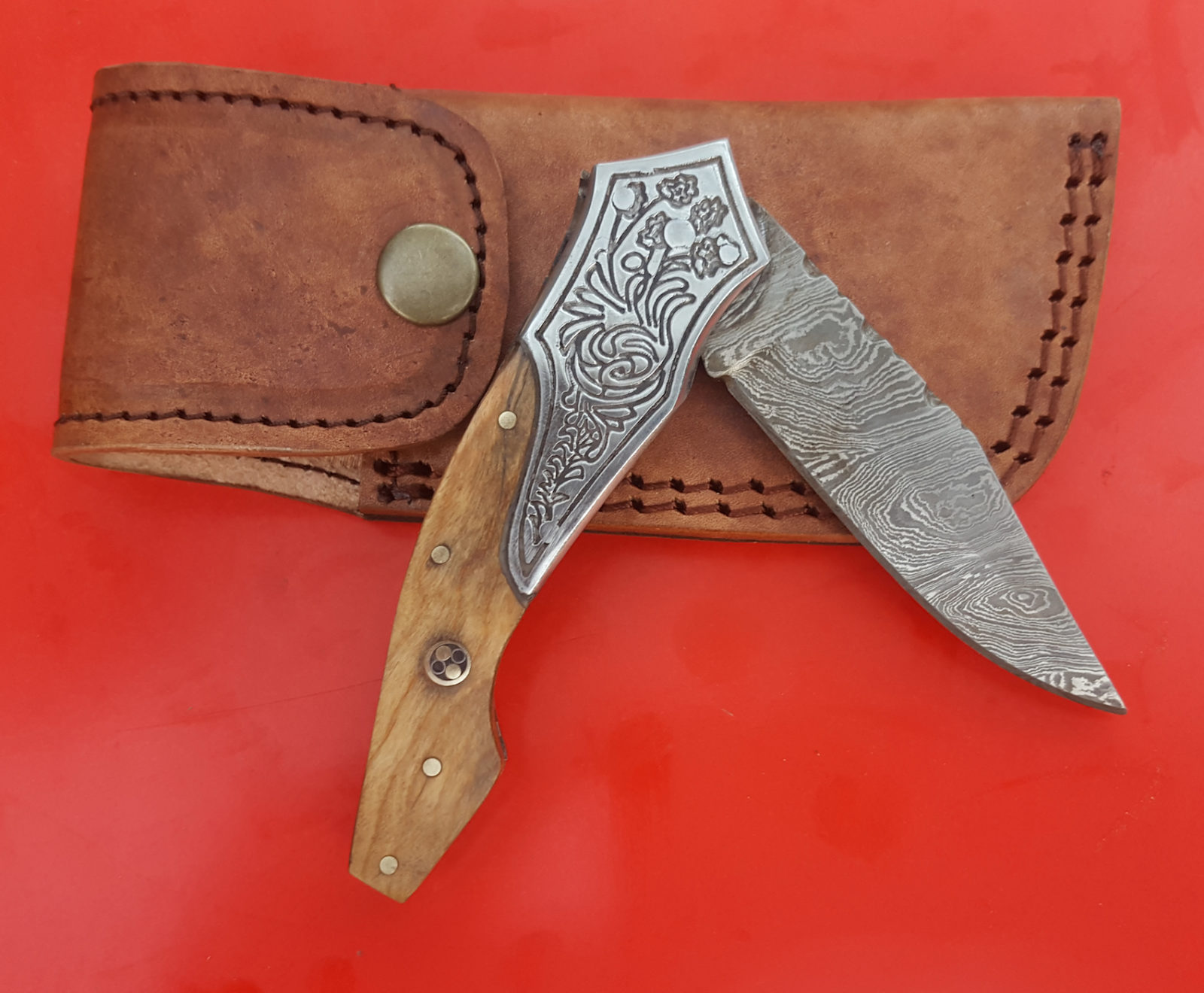 Handmade Damascus Folding Knife, Engraved Steel Bolster Olive wood Mosaic