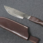 Damascus hand forged Steel blade, full tang, leather strap