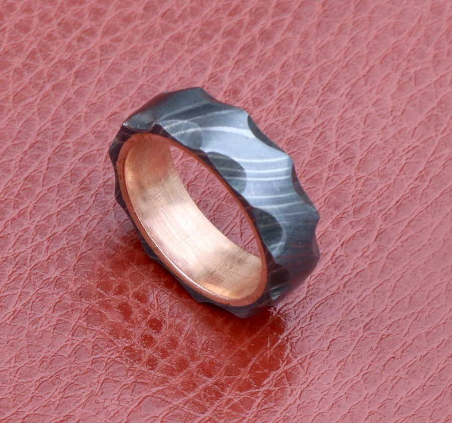 men Damascus wedding band wit copper inlay