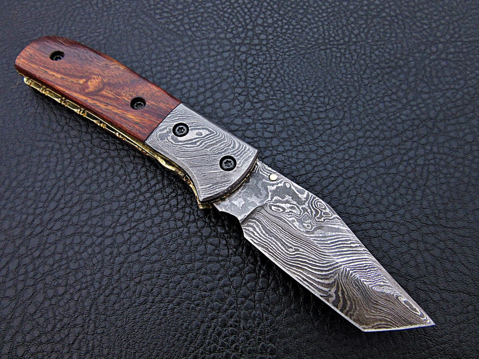 Hand forged Damascus steel folding knives