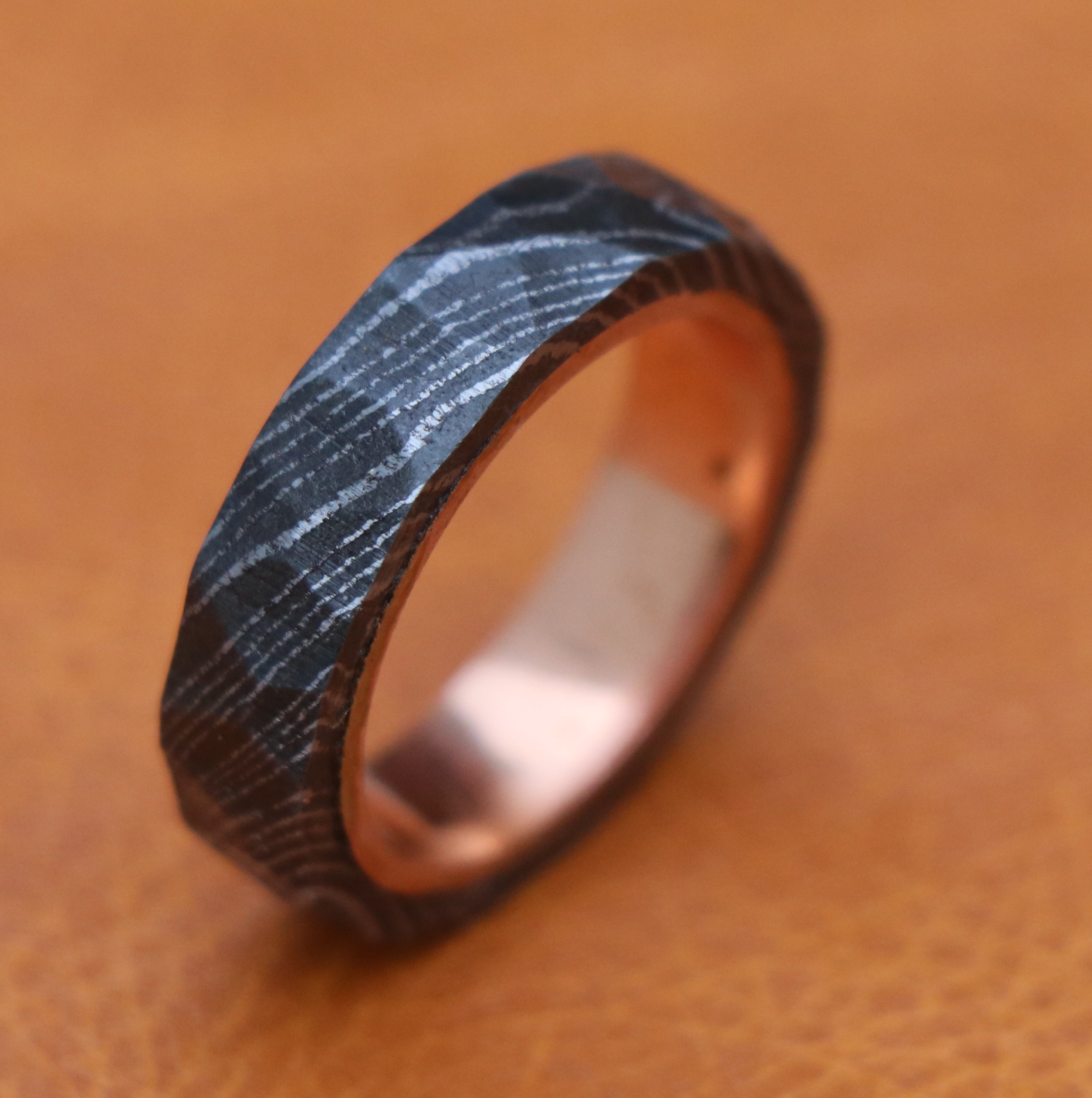 Damascus steel wedding band copper inlay