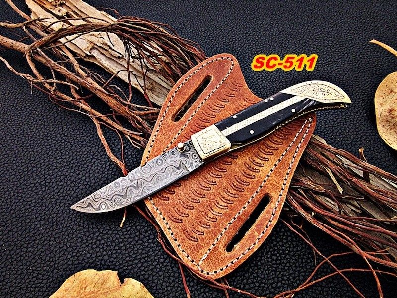 Damascus steel knife buffalo handle and engraved