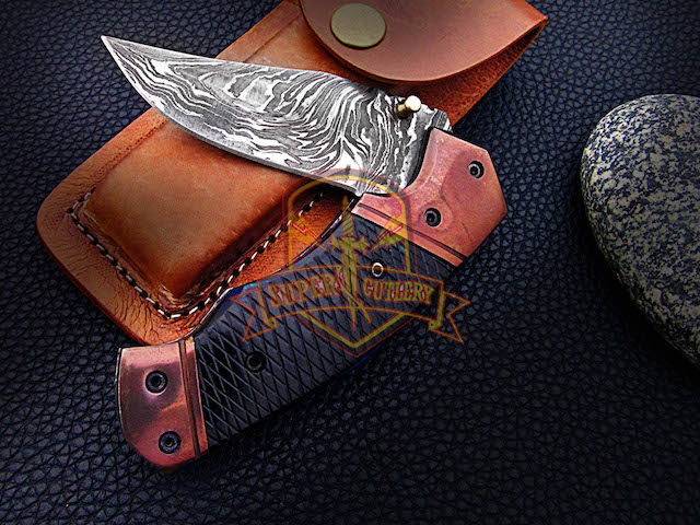 Handmade Damascus folding knife bull horn