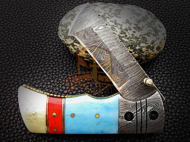 Colored bone damascus steel folding knife
