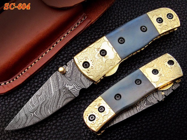 Damascus pocket knife engraved bolster